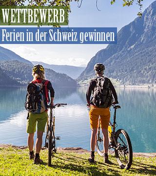 Personen mit Fahrrad in der Schweiz